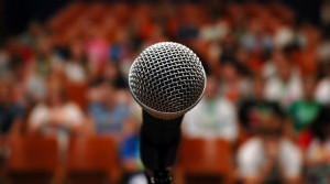 microphone-and-crowd-e12639204361031